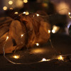 Guirlandes sur piles micro LED blanc chaud