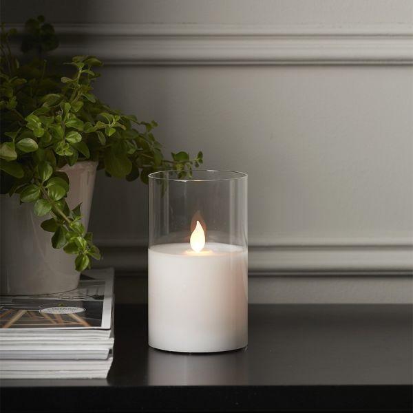 bougie en cire blanche avec flamme vacillante eclairage design. Black Bedroom Furniture Sets. Home Design Ideas